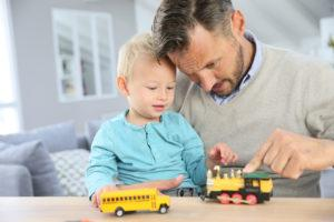 daddy and son playing with toy cars