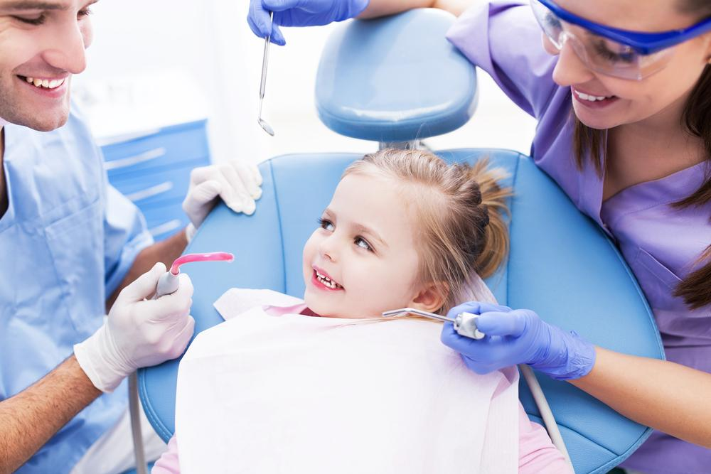 little girl at the dentist clinic