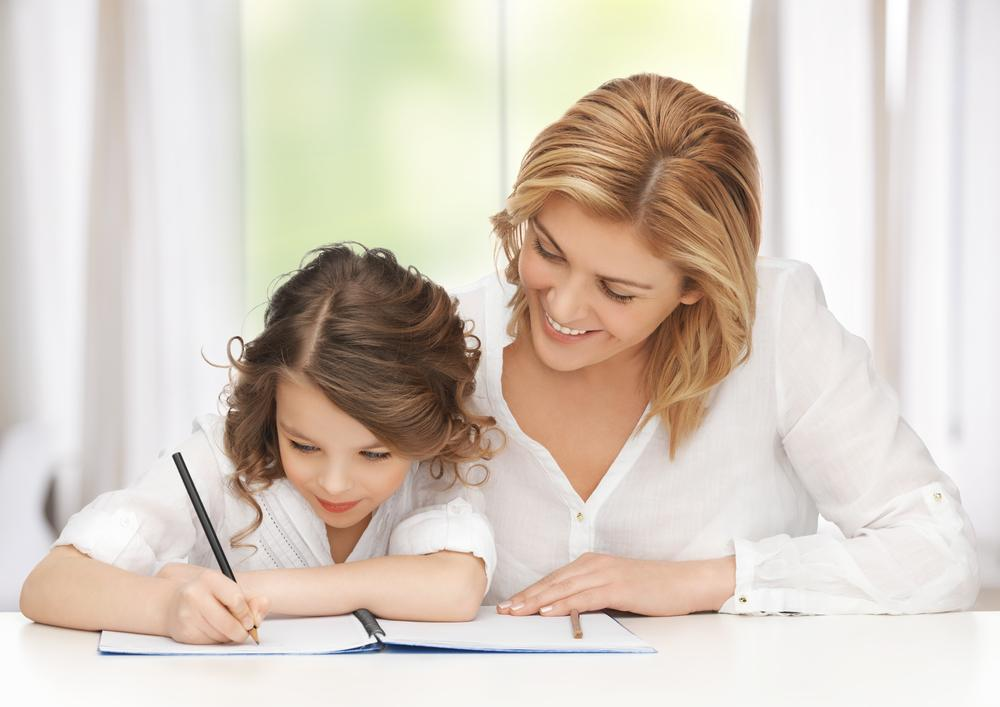 mother and daughter doing homework