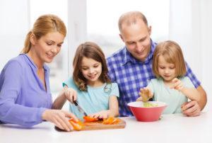 parents and kids preparing dinner