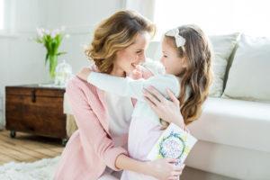 daughter giving mom a hug