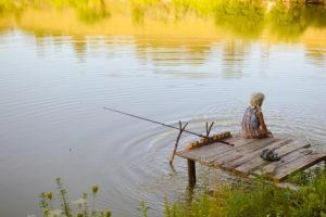 young girl fishing alone in the lake