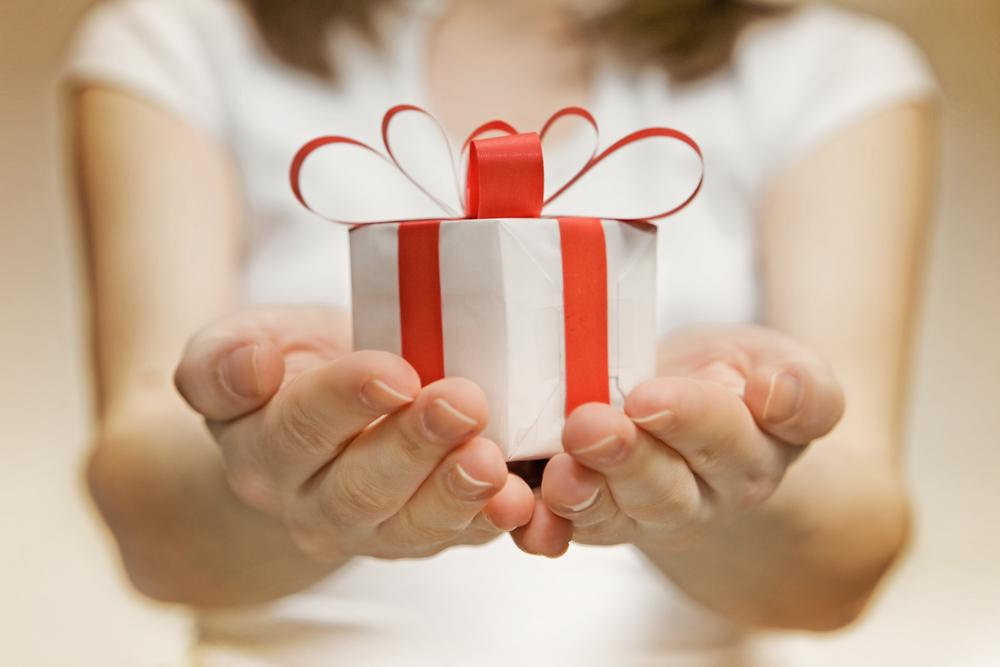 woman holding a tiny christmas gift