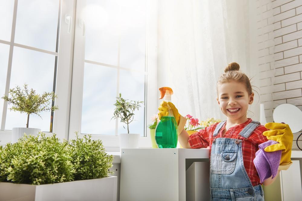 little girl doing house chores